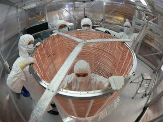 A team works on assembling the XENON1T dark matter experiment..